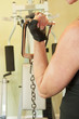 Woman using exercise equipment for arm curls