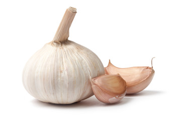 Single garlic bulb with two cloves on white