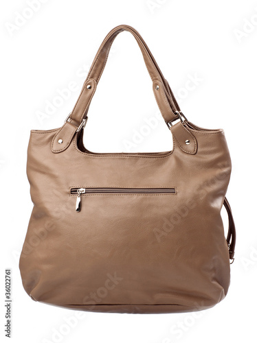 Brown female bag over white