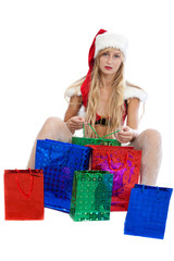 christmas girl with a lot of bright gift packets