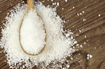 Coarse sea salt on a wooden spoon