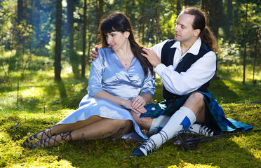 Woman and man in scottish costume outdoor
