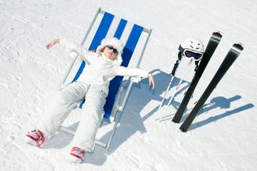 Ski  vacation - little skier in winter resort