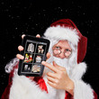 Santa Claus placing orders on his tablet-pc