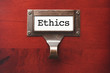 Lustrous Wooden Cabinet with Ethics File Label