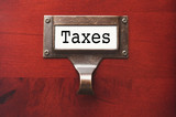 Lustrous Wooden Cabinet with Taxes File Label poster