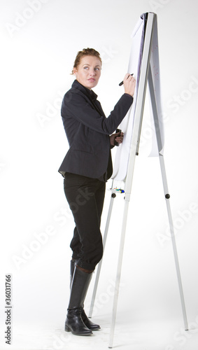 businesswoman at whiteboard