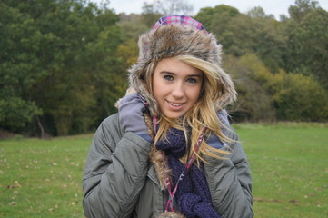 Pretty girl wrapped up warm on a chilly day