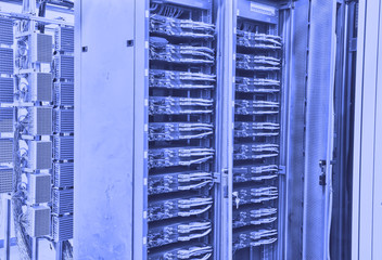 network cables and servers in a technology data center .