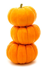 Three stacked mini pumpkins