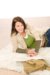 Student female teenager read books lying floor