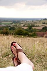 feet crossed relaxing in flip flops