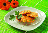 Fototapety Pancakes with vegetables - zucchini, potatoes, carrots, onion an