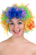 happy girl in a colorful wig