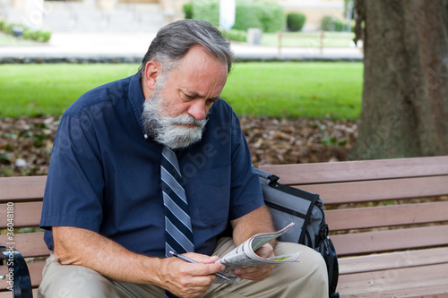 Man Looking At Job Ads