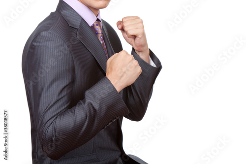 angry businessman showing his fists ready to fight