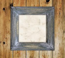 Shabby chic frame on wood