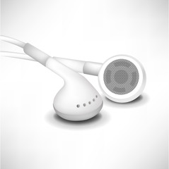 two white headphones in close up