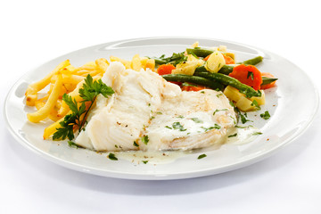 Fish dish - fish fillet, French fries and vegetables
