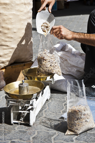 Vendor weighing bakhoor