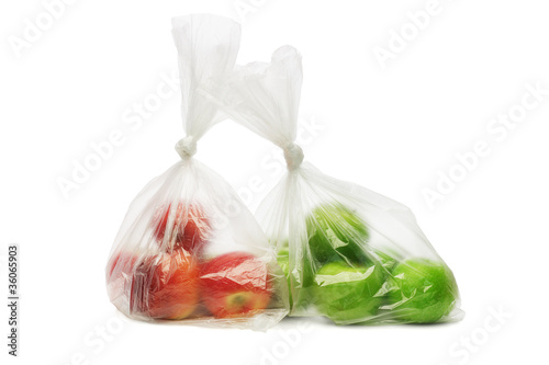 Red and green apples in plastic bags