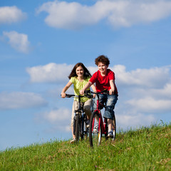 Girl and boy cycling