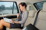 Fototapety Executive businesswoman work laptop car backseat