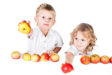 Two kids offering apples isolated on white background