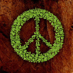 green plant peace symbol on stone background.