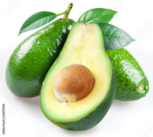 Ripe avacados with leaves.