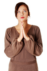 Yuong girl standing and praying.