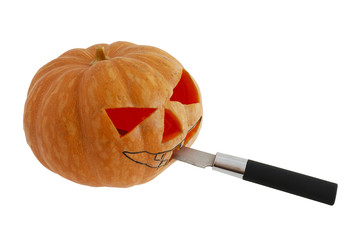 Halloween jack o lantern  carving pumpkin with knife