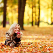 woman eat apple in autumn park