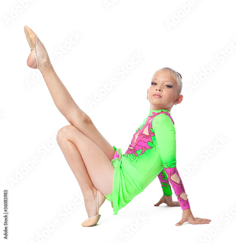 Young teenager girl doing gymnastics exercise
