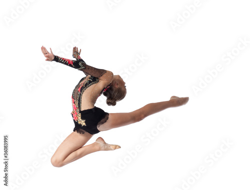 Young professional gymnast jump in dance