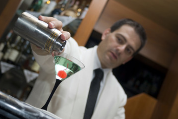 Barman prepares of a cocktail
