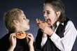 Boys eating Halloween cookies