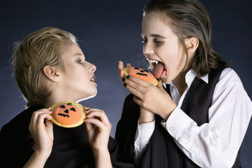 Boys eating Halloween cookies