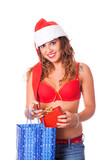 Sexy Woman with Santa Hat and Christmas Gift