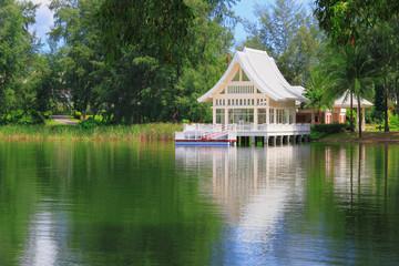 white house near a lake