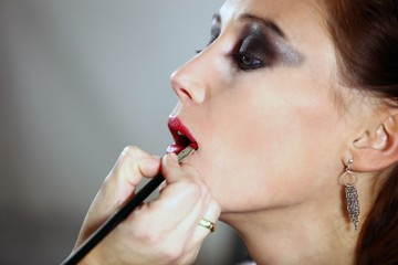 make-up artist at work (focus on mouth)