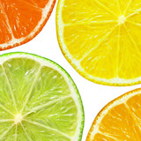 Lime, grapefruit, orange and lime slices isolated on white