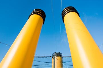 three yellow funnels
