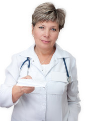 Woman doctor holding a prescription