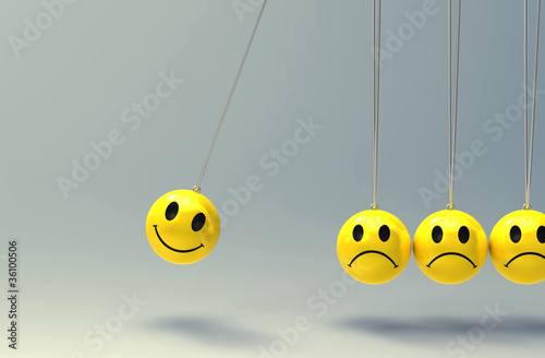 newtons cradle made from smiley faces