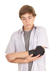 young man with elbow in medical bandage, elbow support