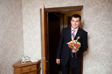 groom with a bouquet