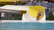 Senior couple Having Fun On Water Slide