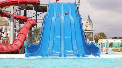 Sliding down on water slide in waterpark