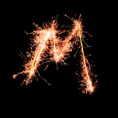 Letter M. Real sparkler alphabet